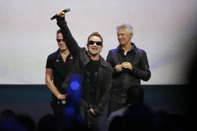 U2 at the iPhone release event.