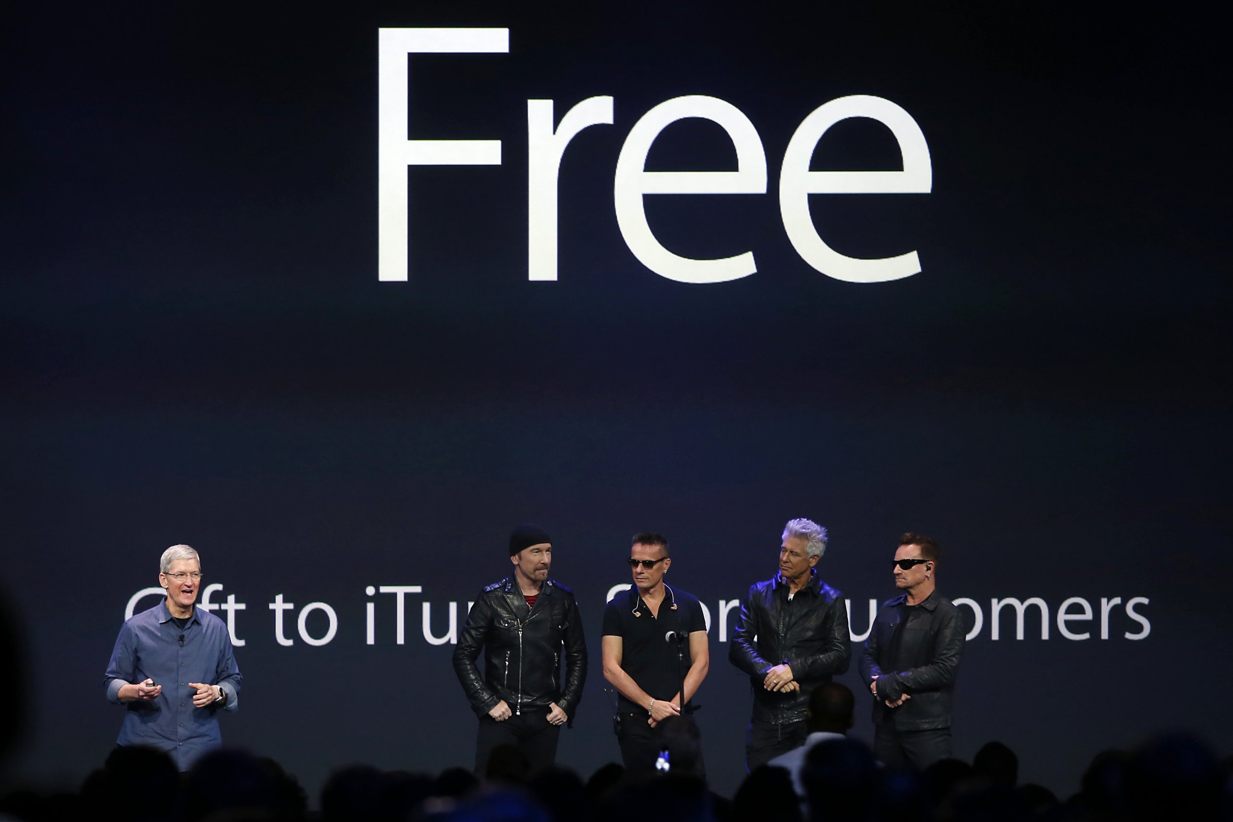 U2, with apple CEO Tim Cook.