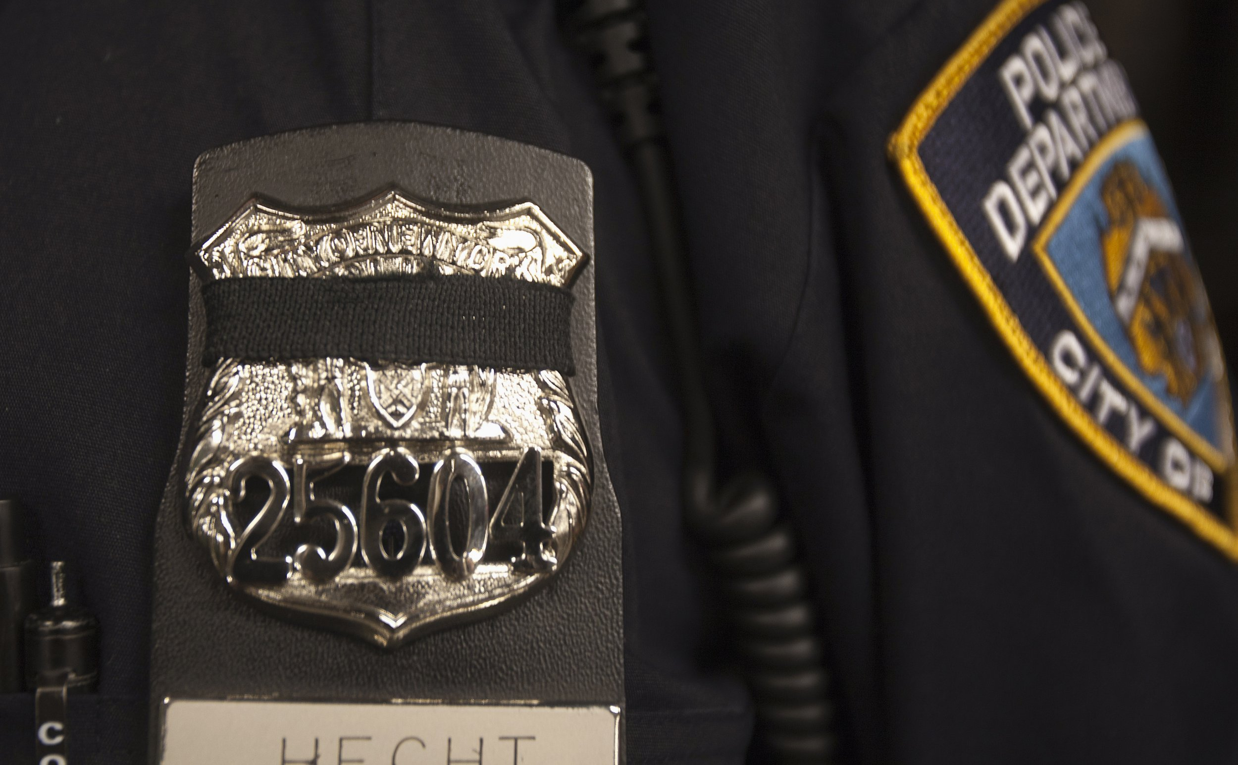 Mourning the Fallen: Police Wear Bands for Slain NYPD Officers