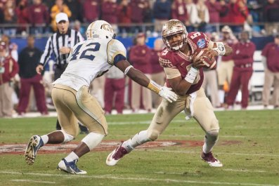 2014-12-07T052021Z_634482923_NOCID_RTRMADP_3_NCAA-FOOTBALL-ACC-FOOTBALL-CHAMPIONSHIP-FLORIDA-STATE-VS-GEORGIA-TECH