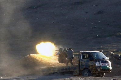 Syrian Rebels fire at Islamic State