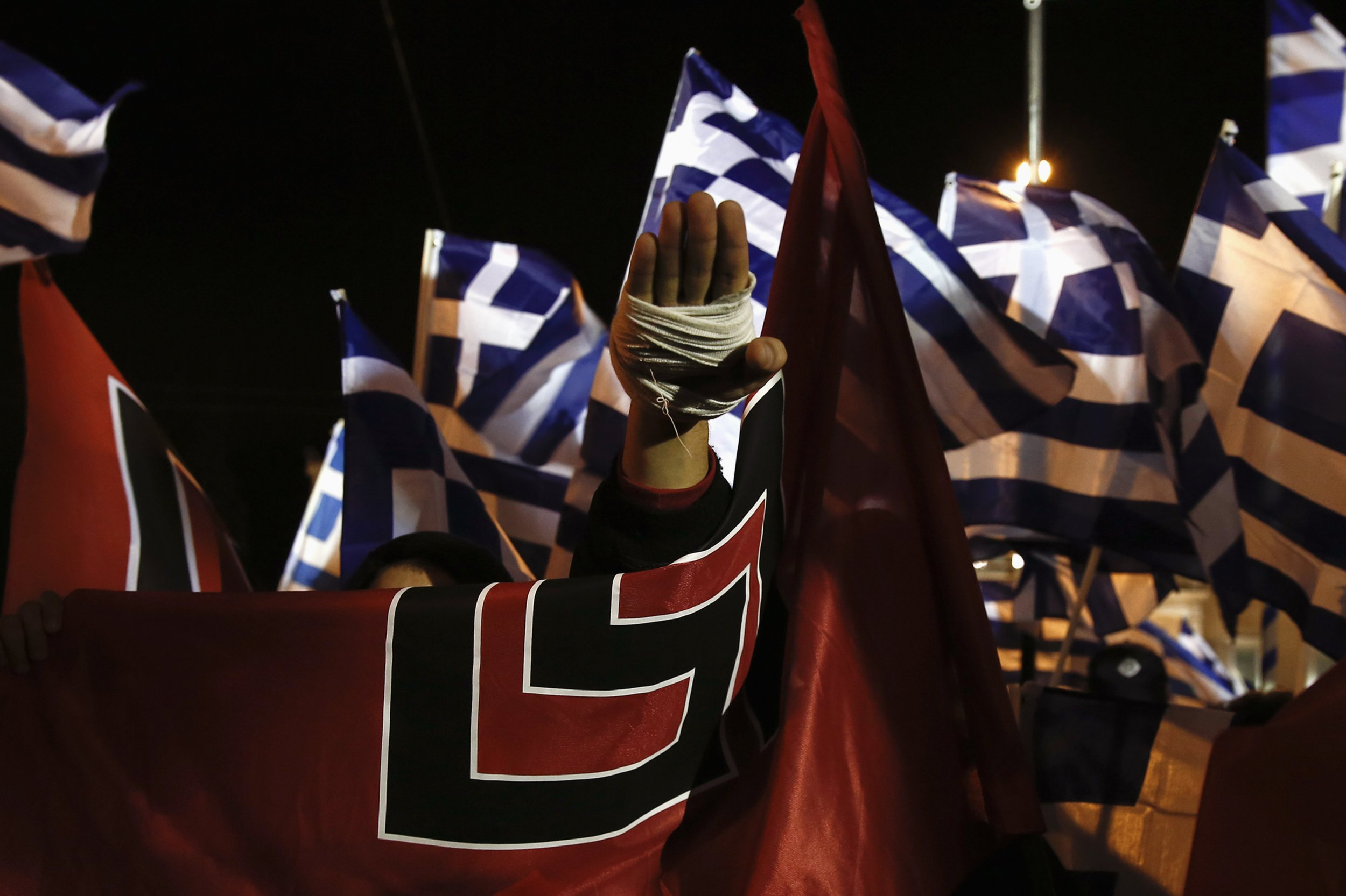 A supporter of Greece's far-right Golden Dawn party salutes in a Nazi style