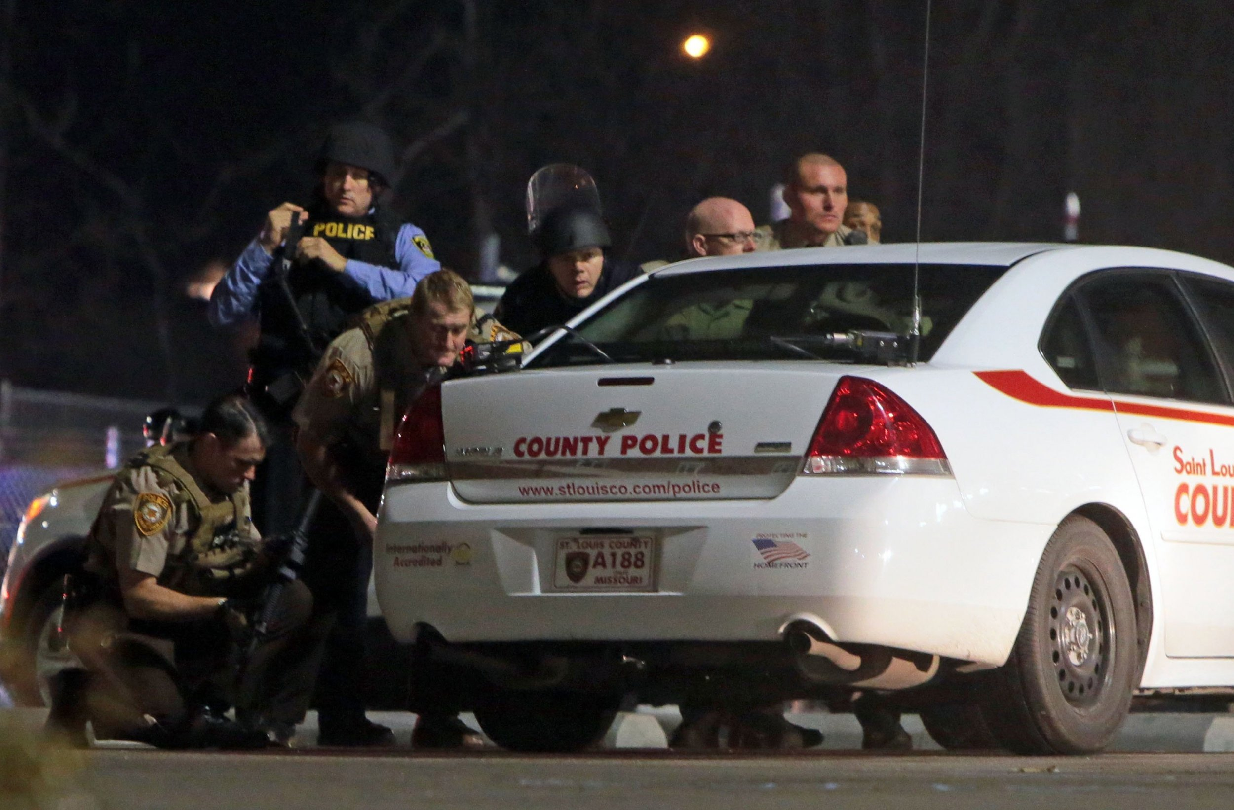 police swarm house in ferguson police shooting investigation