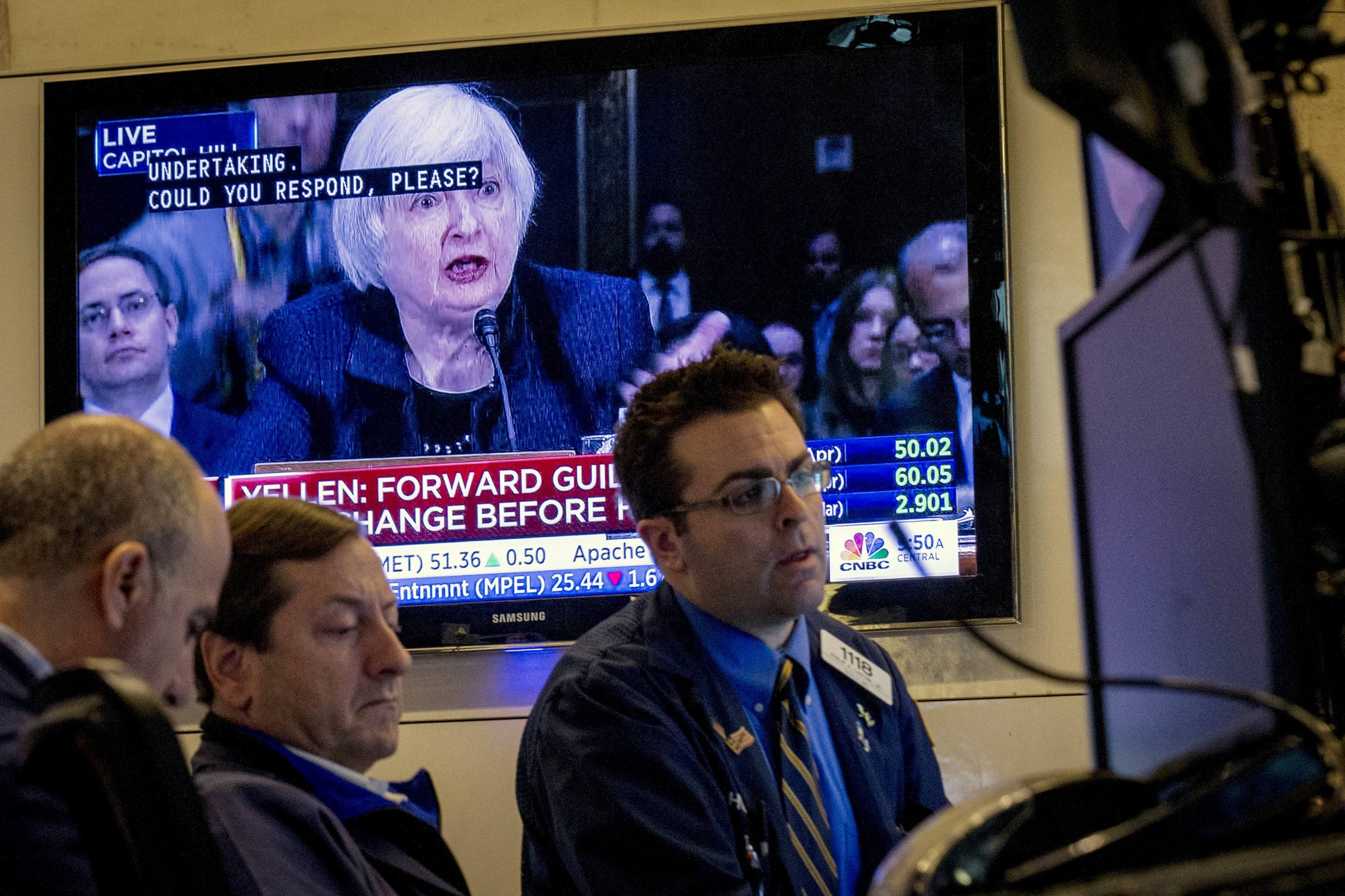rate hike hints send oil up and dollar down
