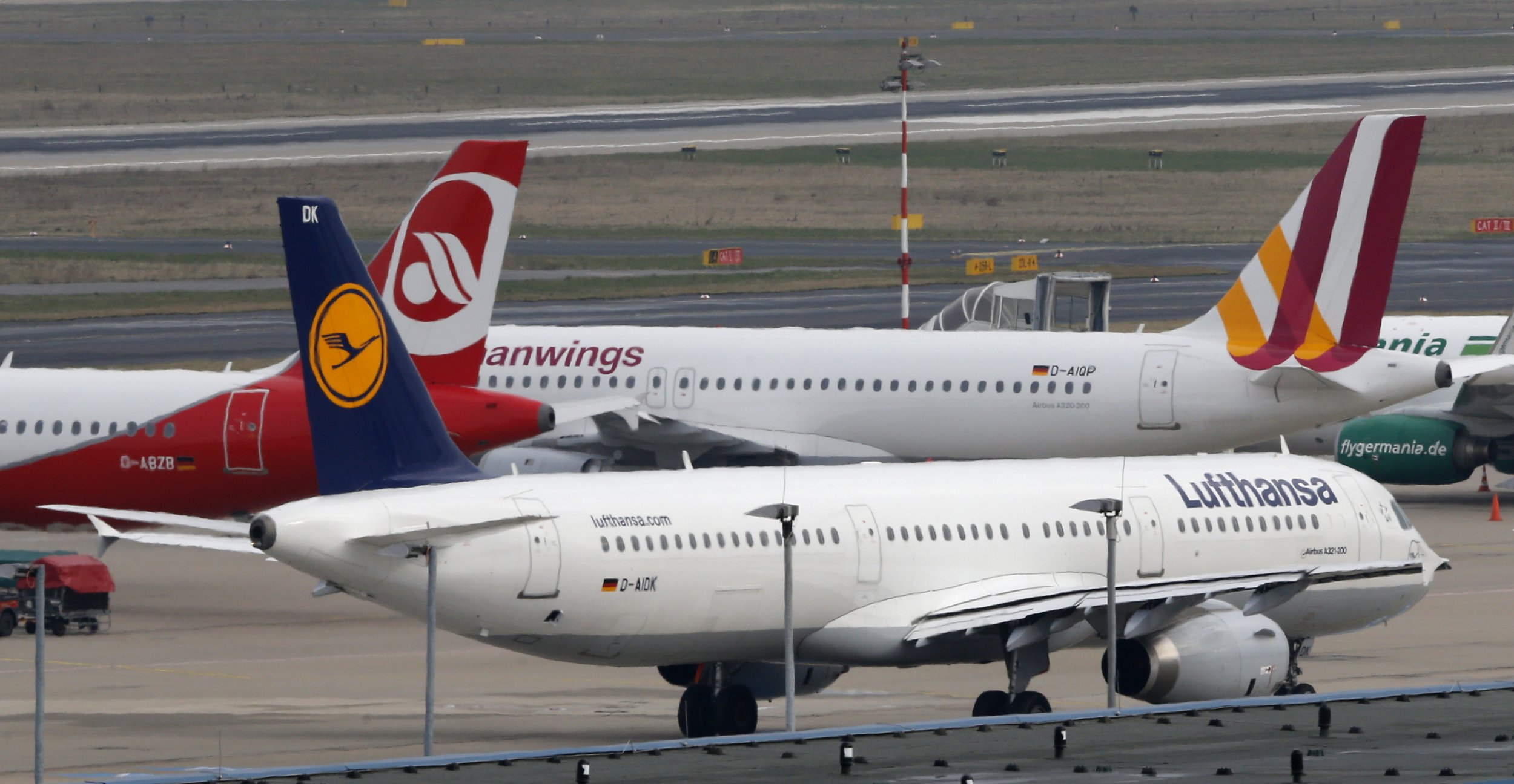 A Lufthansa Airbus A318 plane with relatives of people who died in a plane crash in the French Alps, taxi at the Duesseldorf airport March 26, 2015.