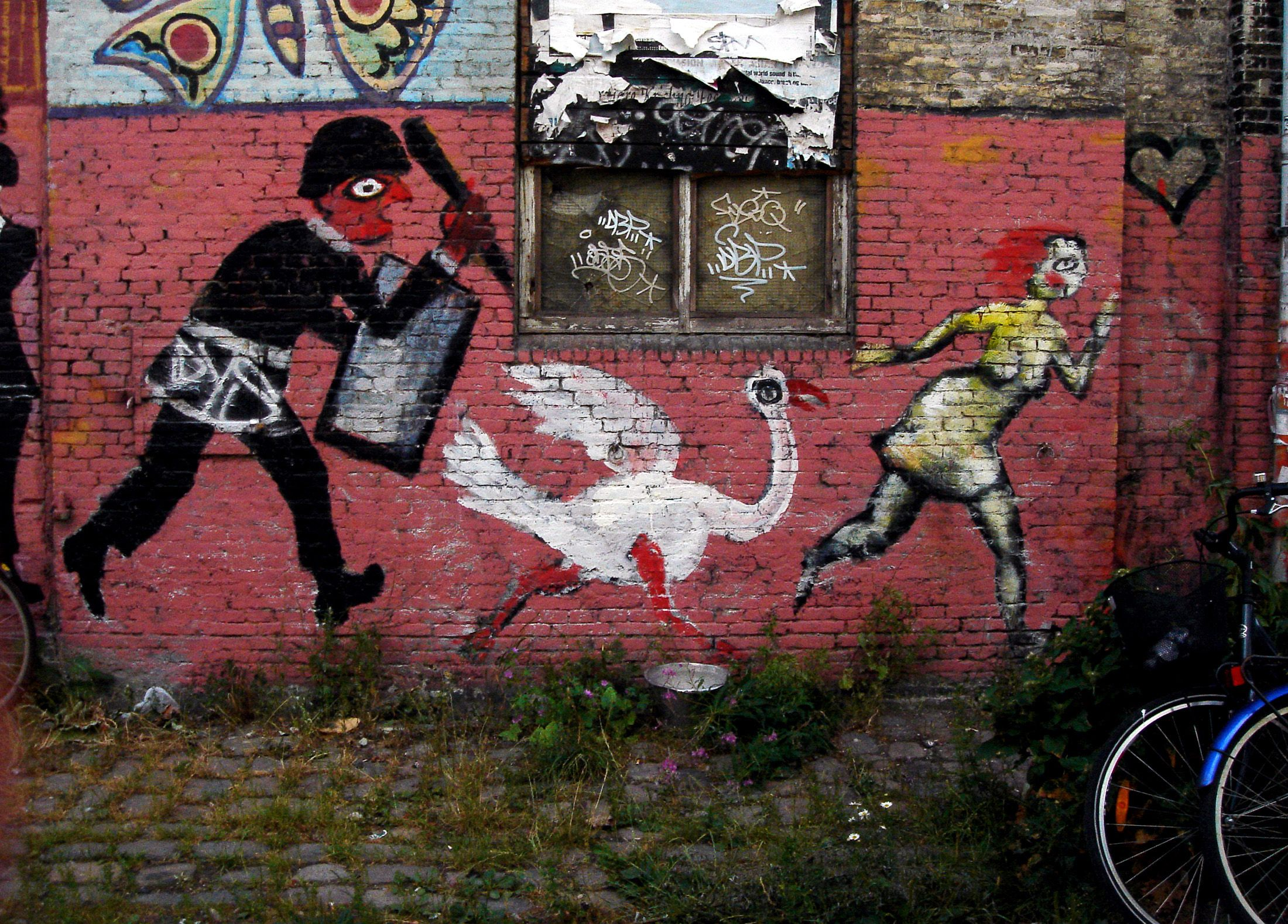 A painting of a police raid on a wall in Christiania, Denmark
