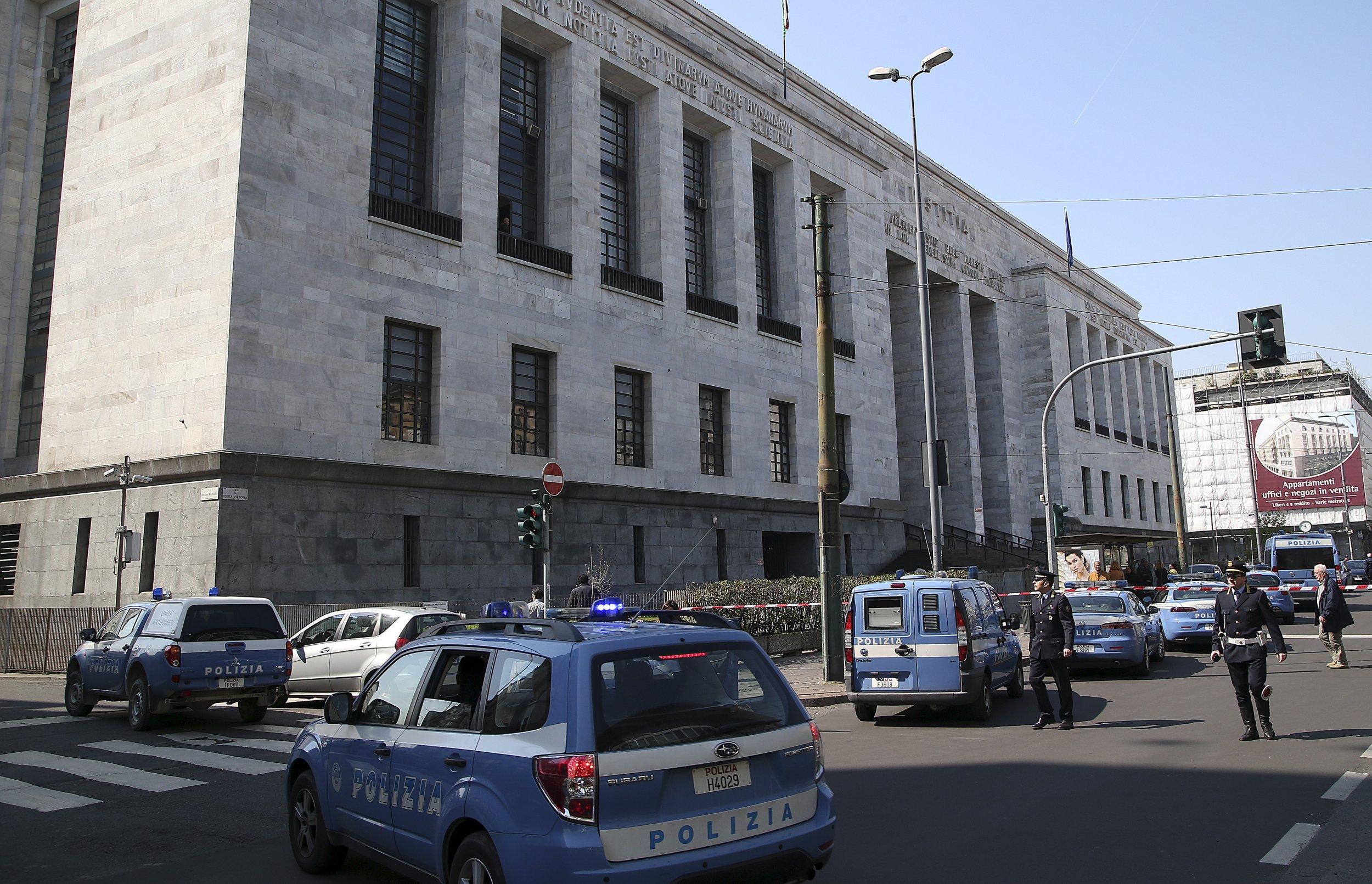 Police cars surround the tribunal of Milan April 9, 2015.