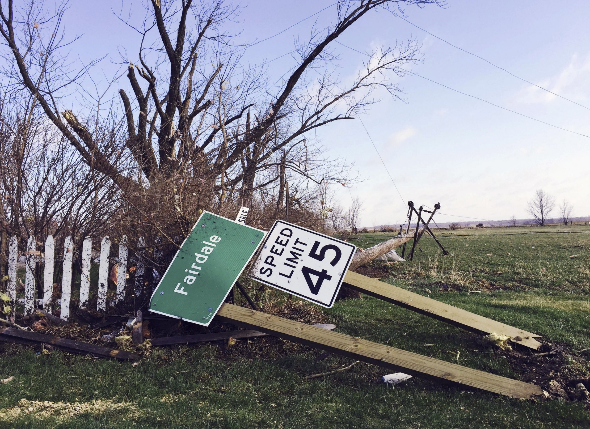 Sign lies on the ground in fairdale illinois on april 10 after a