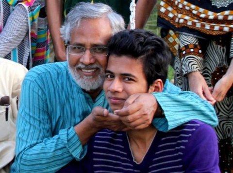 Shakkel Auj and his son