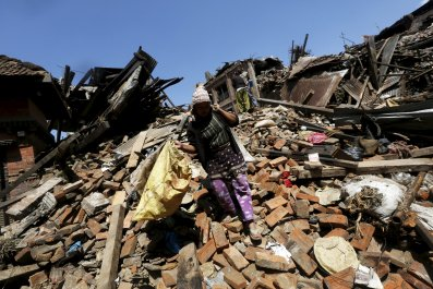 Nepalese woman rubble