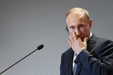 Vladimir Putin at a press conference in Italy
