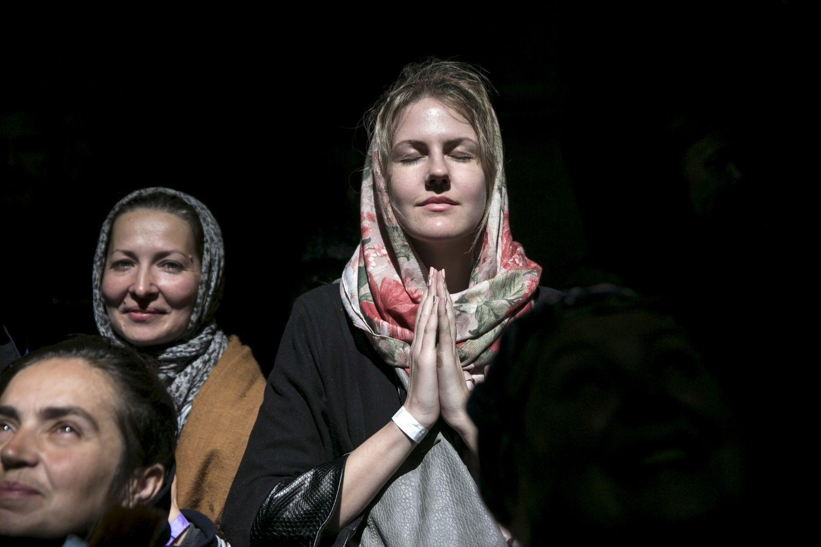 Church worshipper prays