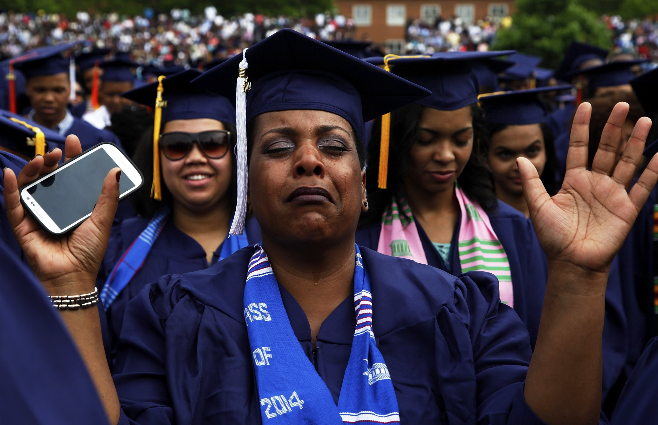 95c7ab2f55 A graduate cries during a prayer at Howard University s 2014 graduation  ceremonies in Washington