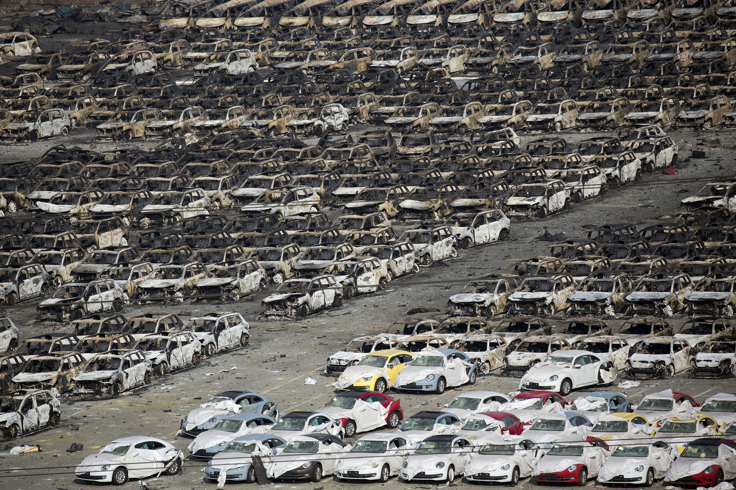 Burnt Cars Are Seen Near The Site Of The Explosions At The Binhai New  District, Tianjin, August 13, 2015. Two Huge Explosions Tore Through An  Industrial ...