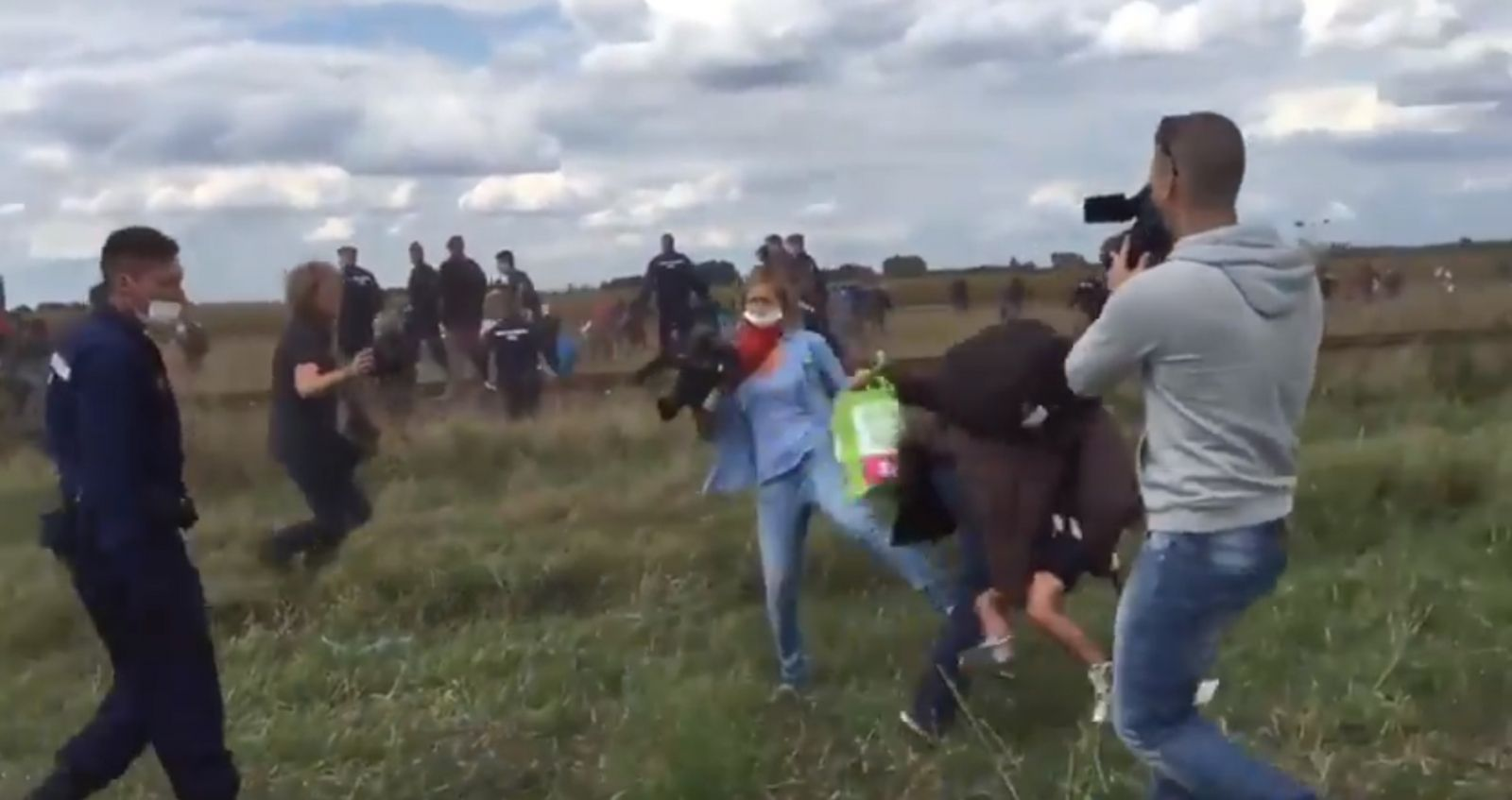 Hungary camerawoman trips refugee