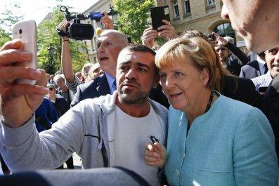 09_11_Merkel_Refguees