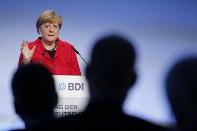 1202_Merkel Refugees