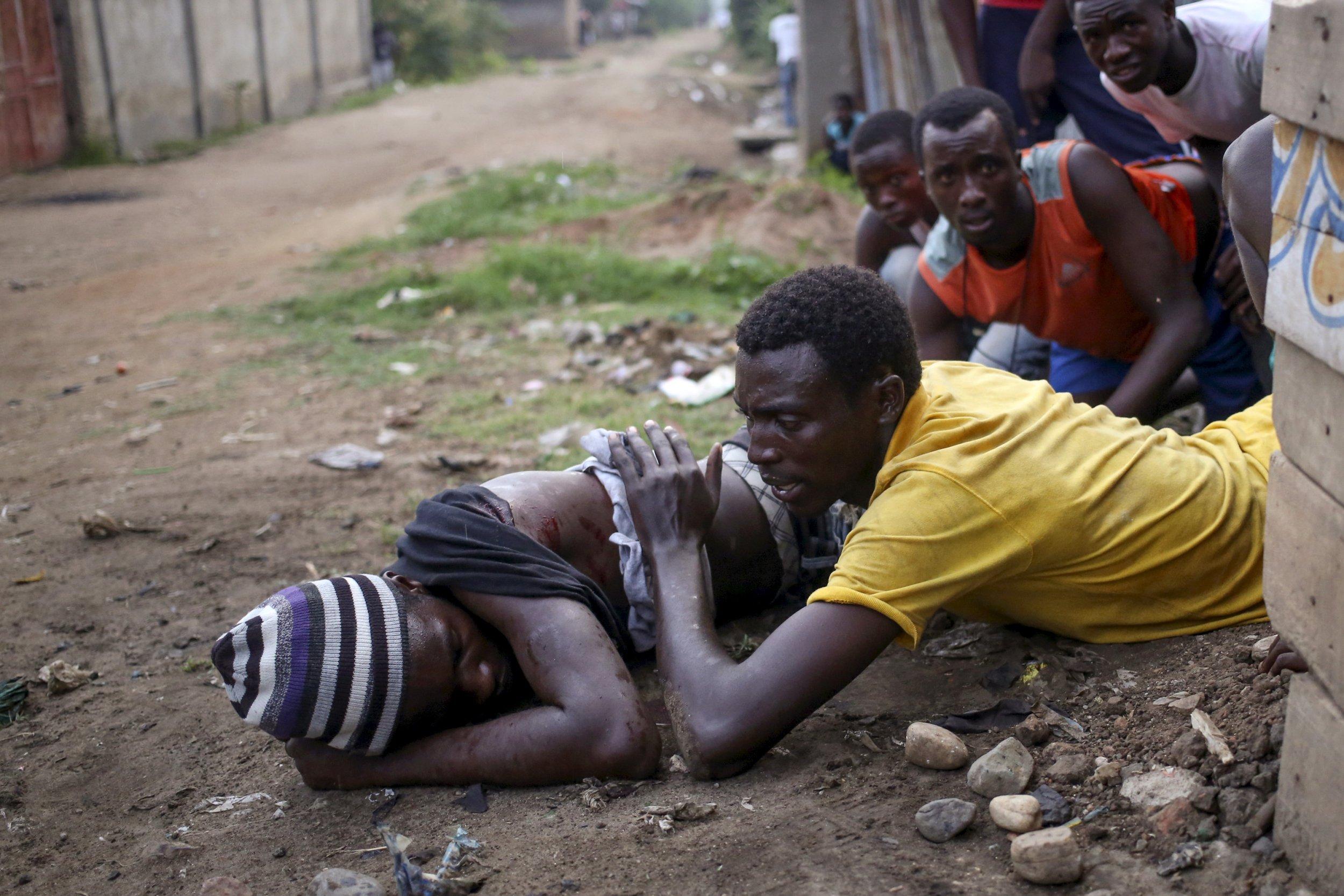 An anti-Nkurunziza protester lies wounded in Bujumbura, Burundi.
