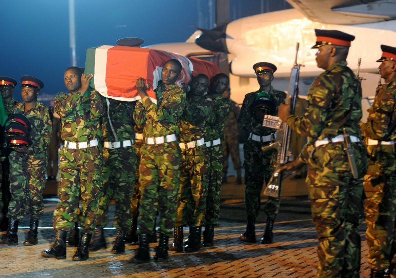 Kenyan soldiers unload the bodies of comrades who died in an Al-Shabab attack in Somalia.