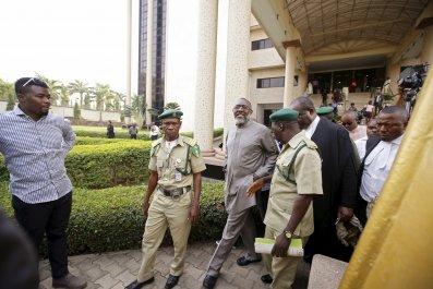 Olisa Metuh leaves court in Abuja, Nigeria.