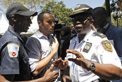 Phil Moore demonstrates for release of Al Jazeera reporters.