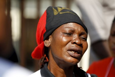 A Biafra supporter of Nnamdi Kanu cries during a rally.