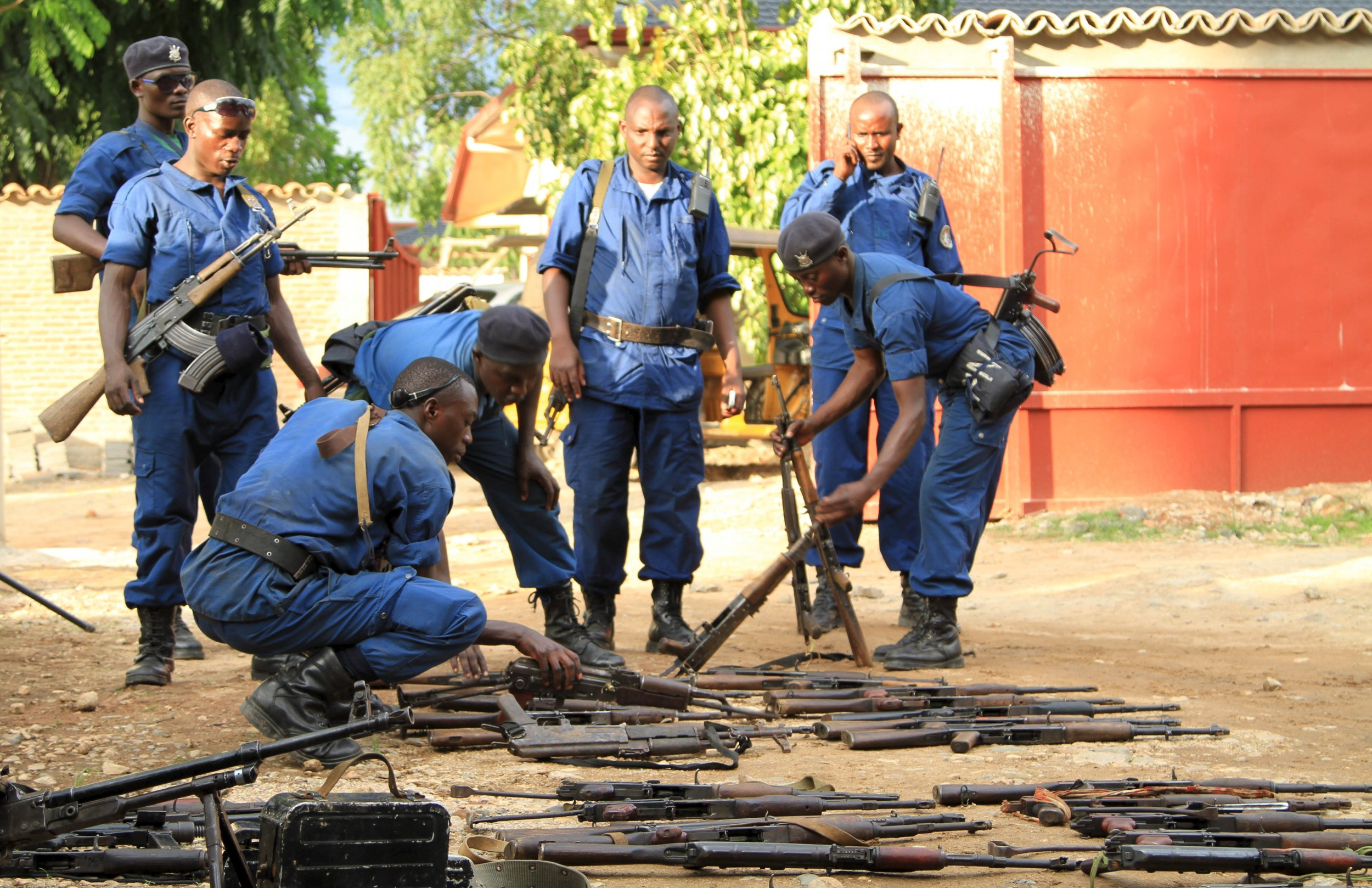 Burundi police collect weapons from suspected fighters in Bujumbura.