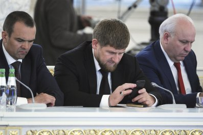 Kadyrov texting in State Council meeting