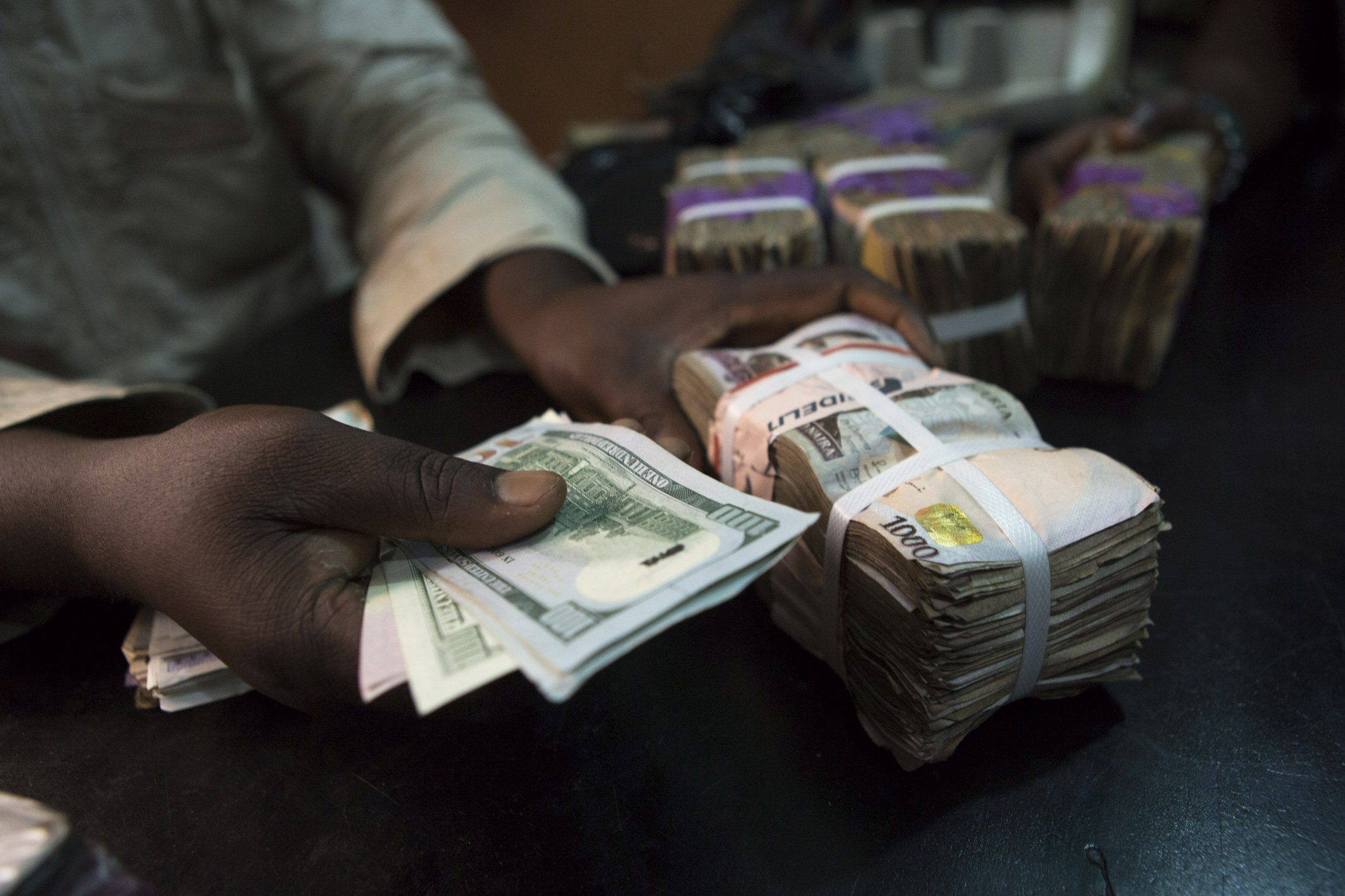A trader changes dollars with naira in Lagos