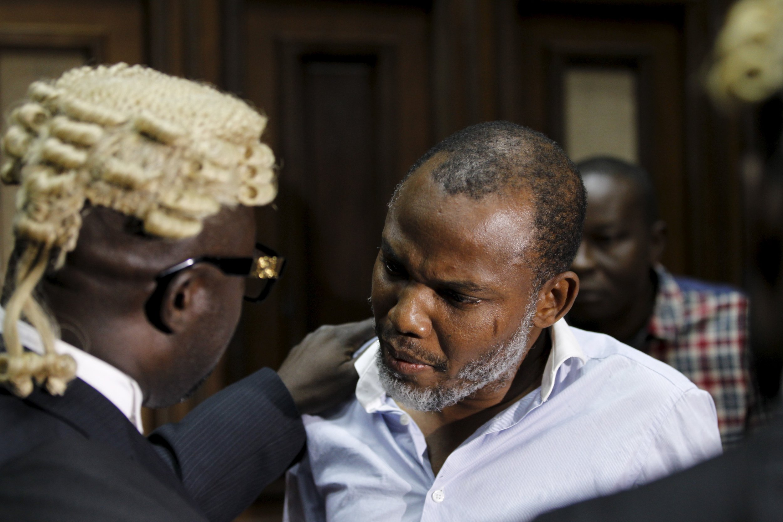 Biafran activist Nnamdi Kanu speaks to his counsel in a court in Abuja, Nigeria.