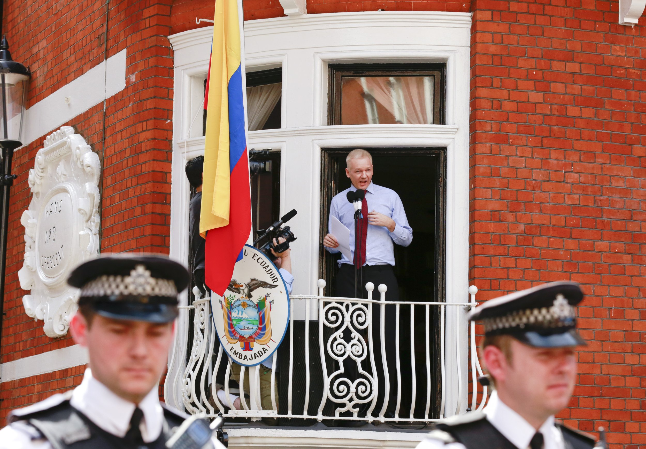 Julian Assange speaks from the balcony of the Ecuadorian embassy