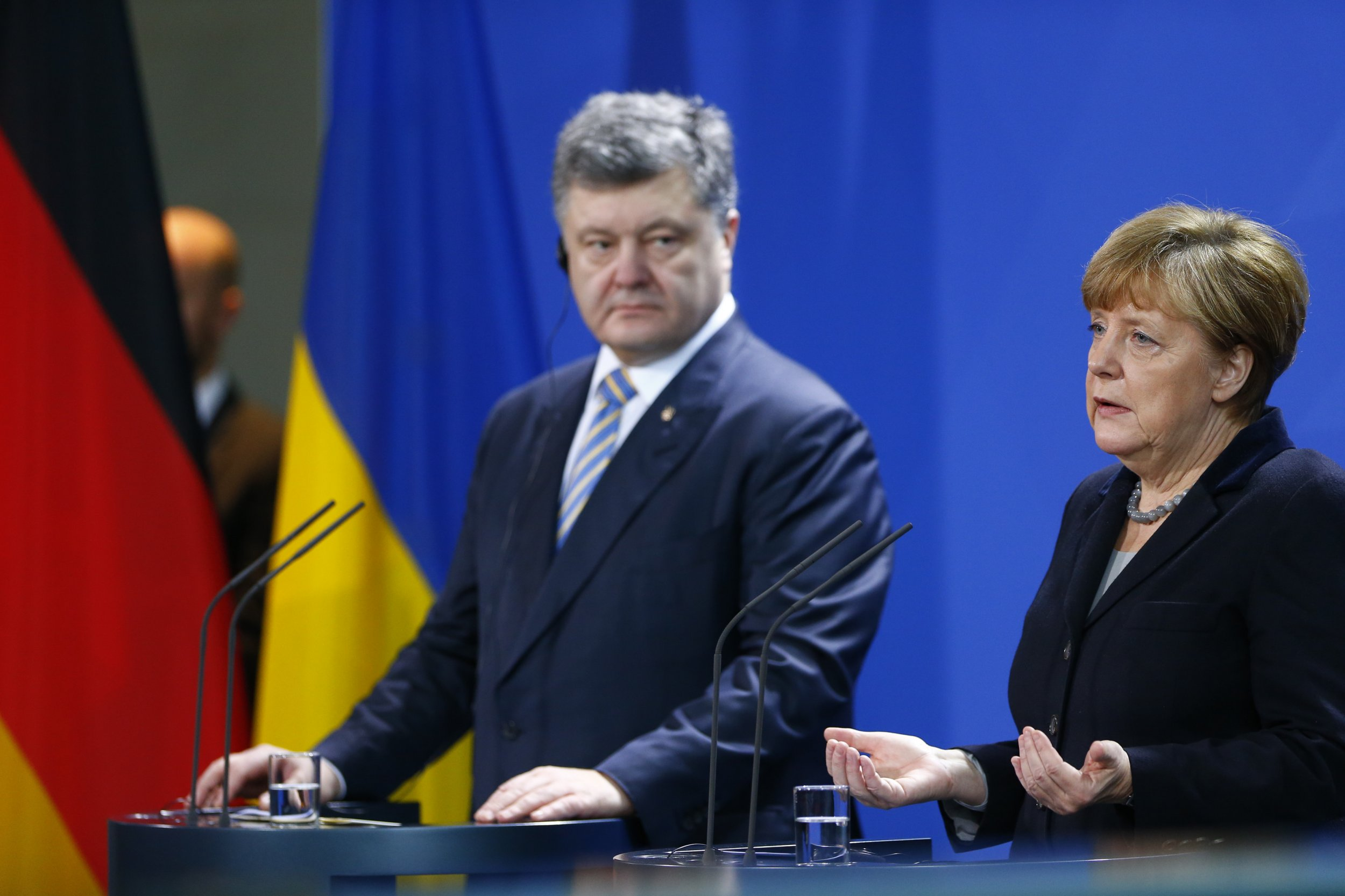 Poroshenko speaks next to German Chancellor Angela Merkel