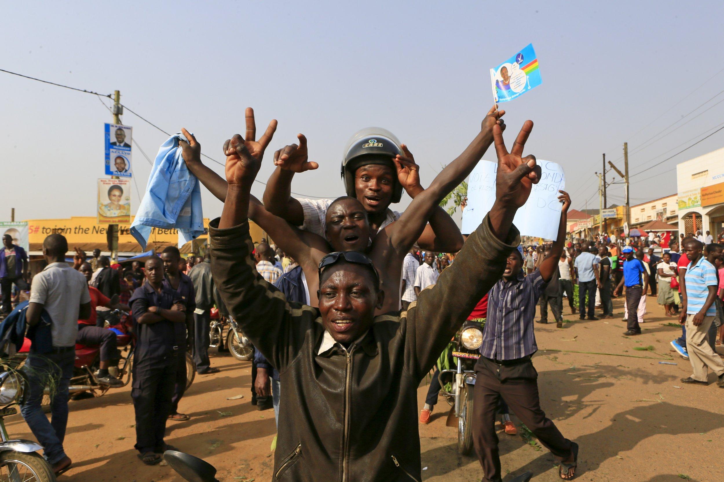 Kizza Besigye supporters gesture in Uganda ahead of elections, where Besigye challenges Yoweri Museveni.