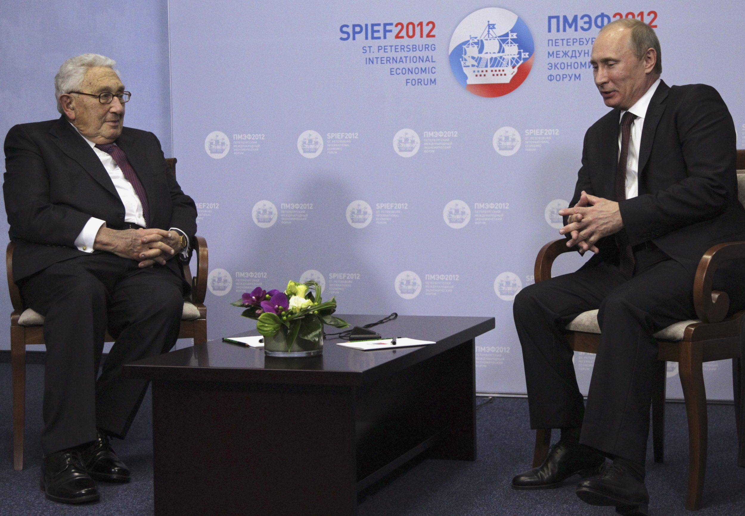 Putin and Kissinger sit at meeting in St Petersburg