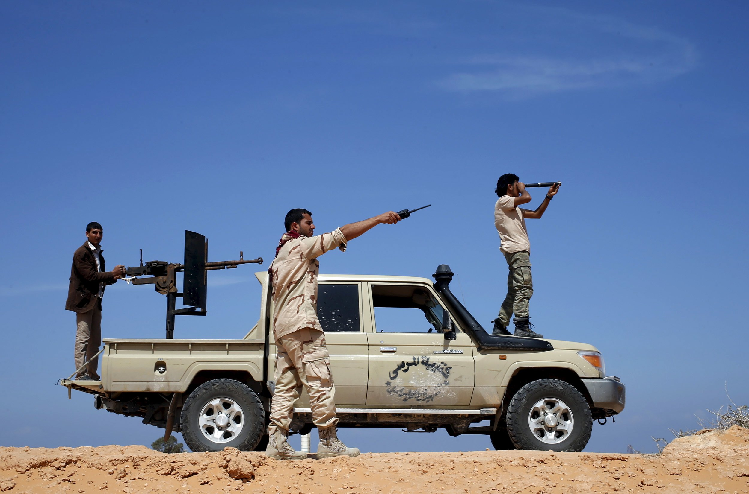 Libya Dawn fighters look at ISIS military positions near Sirte.