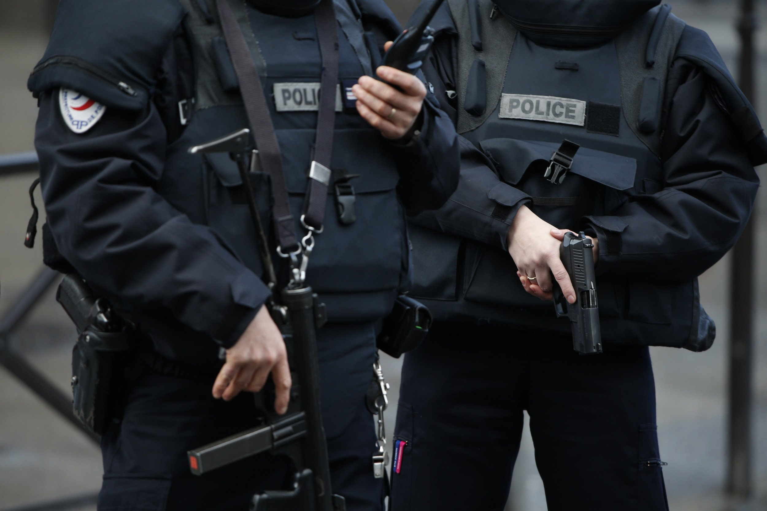French police holding guns