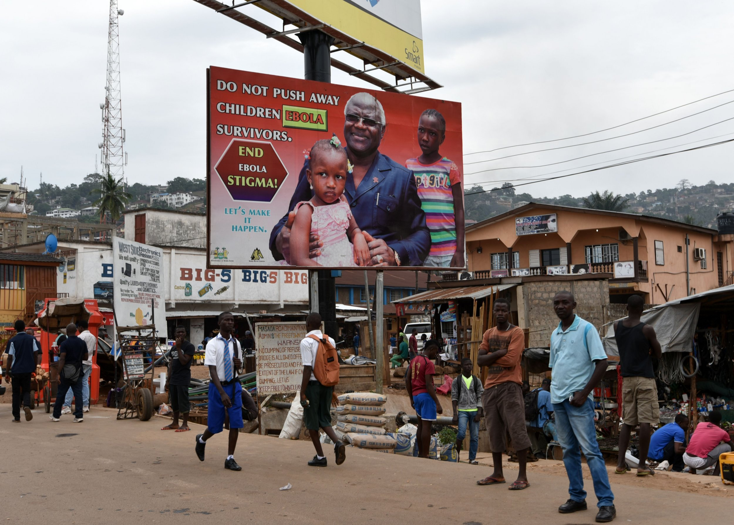 An Ebola poster in Sierra Leone featuring the president, Ernest Bai Koroma, is displayed.