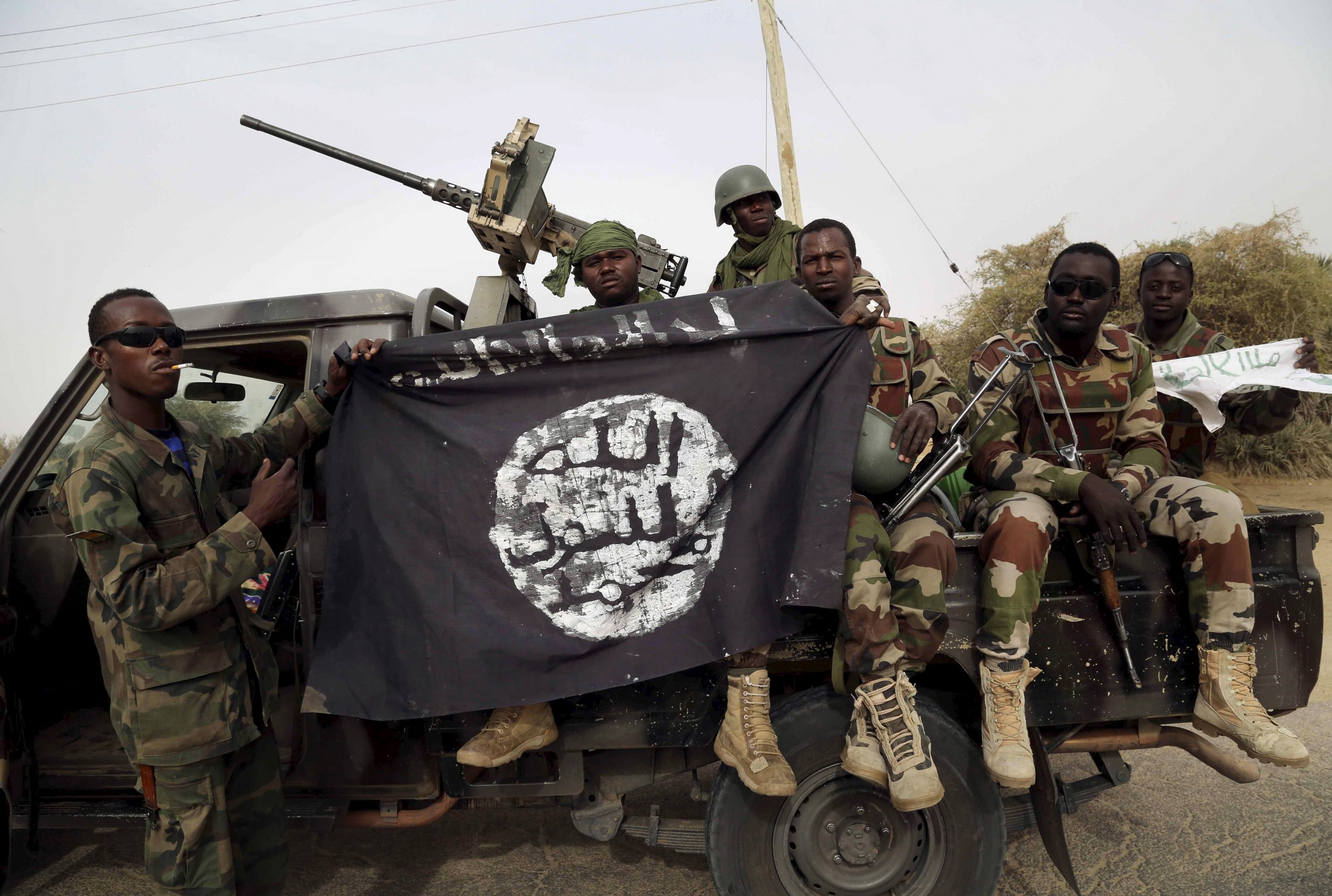 Nigerian soldiers with Boko Haram flag.