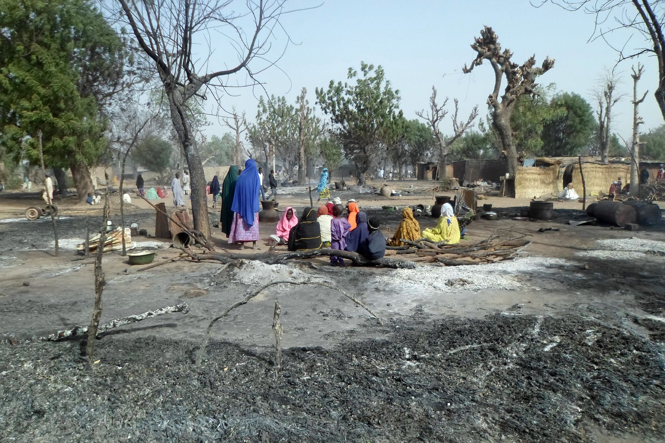 Victims of a Boko Haram attack sit amid burnt houses in Dalori, near Maiduguri, Nigeria.
