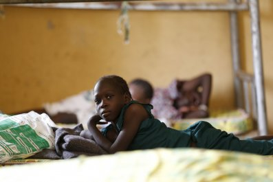 A child rescued from Boko Haram rests in an IDP camp in Yola, Nigeria.