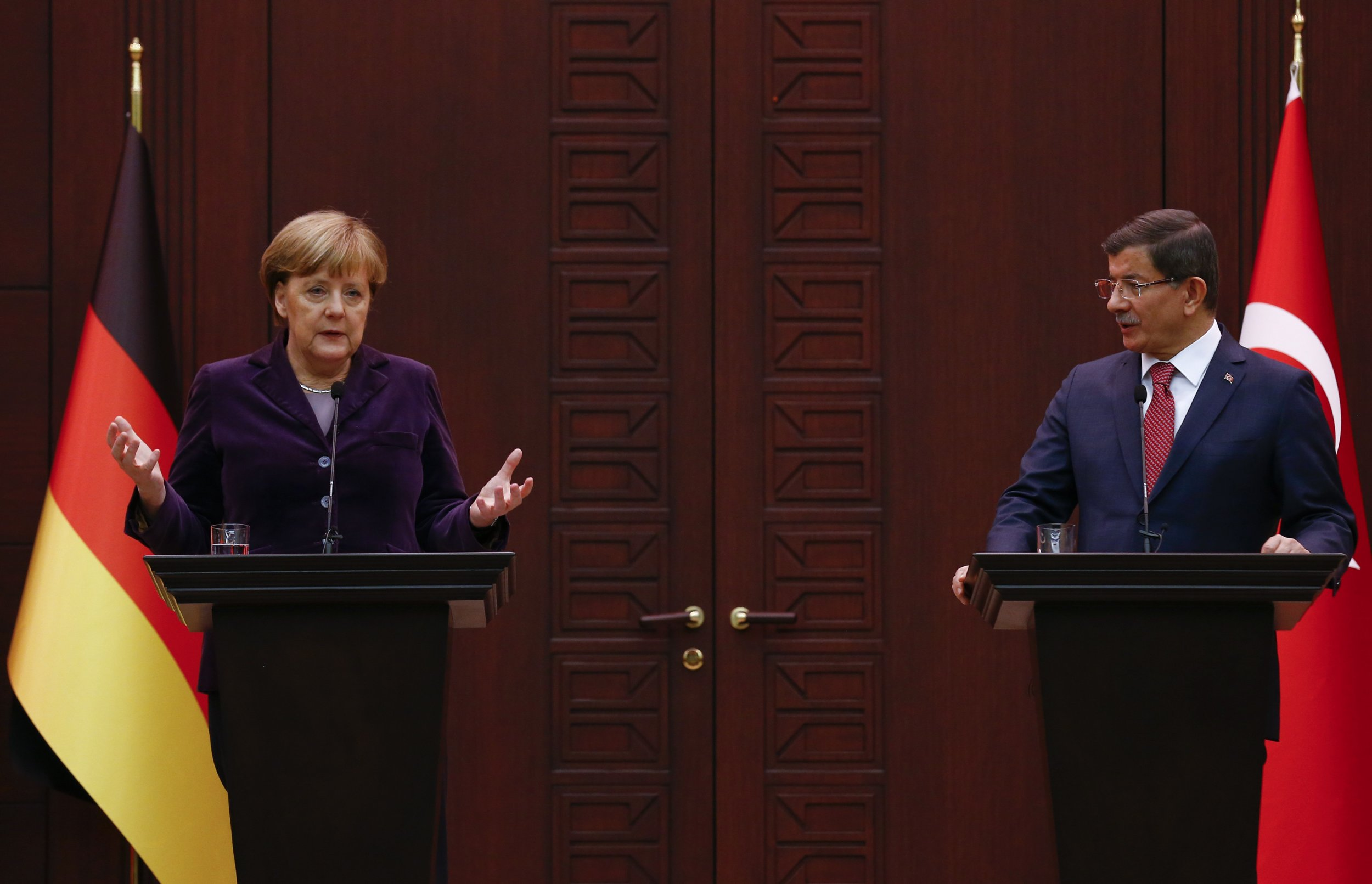Merkel and Davutoglu ask NATO for help with refugees.