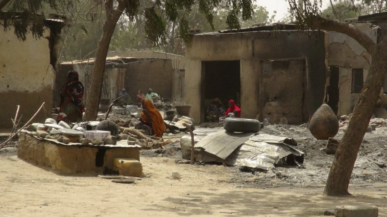 Dalori villagers rest after their houses were destroyed by Boko Haram.
