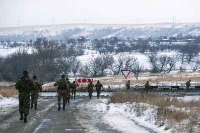 Chechen fighters march on a road in Donetsk region