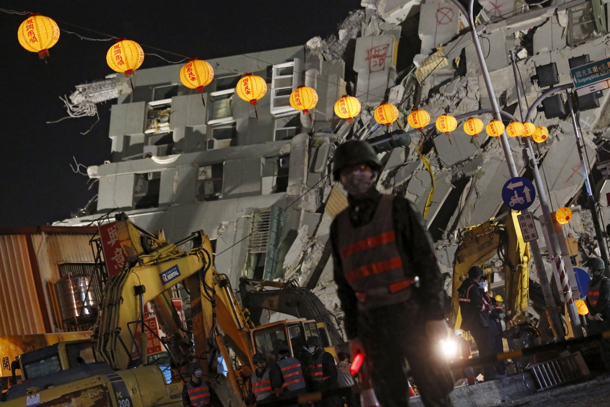 Collapsed building and lanterns