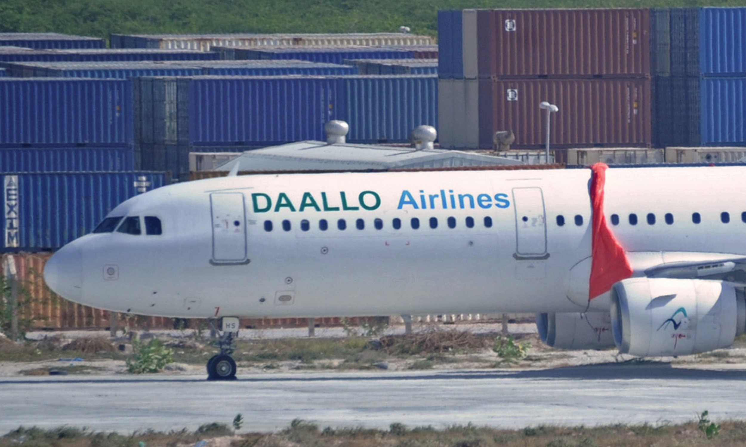 A Daallo Airlines plane in Mogadishu after a suspected suicide bomber blew a hole in the plane.