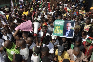 Pro-Biafra supporters carry a poster of Nnamdi Kanu at a protest in Aba, Nigeria.