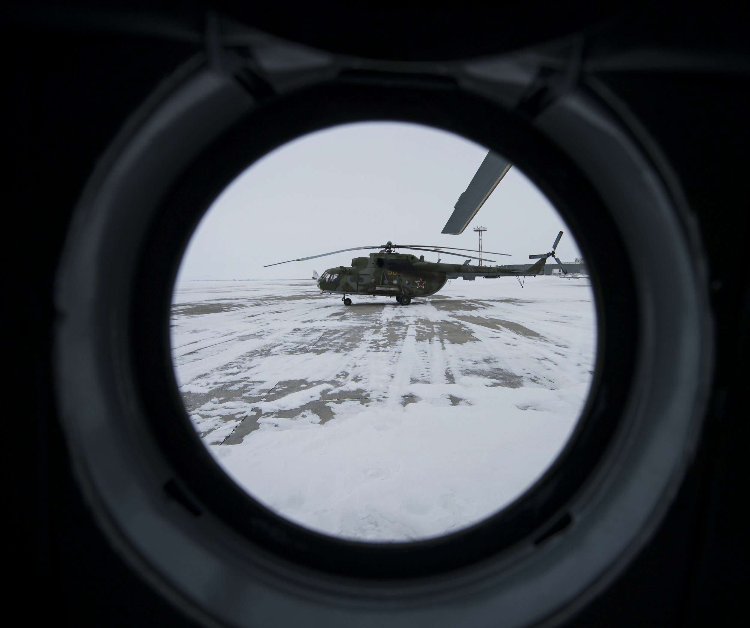 MI8 Helicopter seen through the window of another aircraft