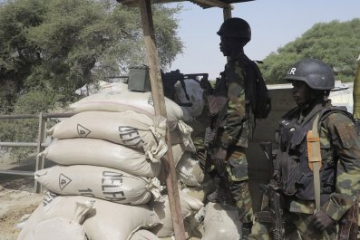 Cameroonian soldiers stand guard in an area attacked by Boko Haram.