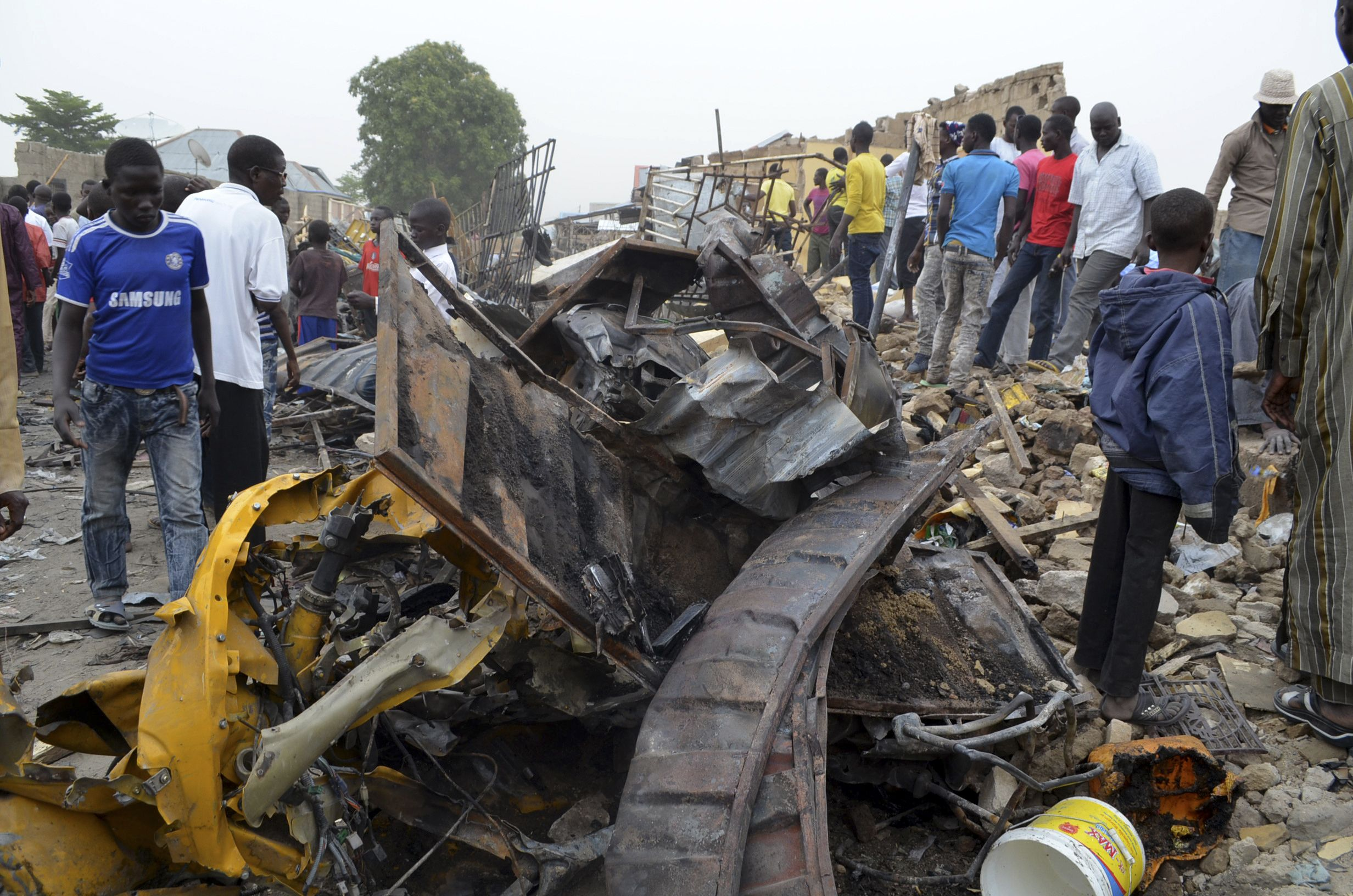 People inspect damage after an explosion in a market in Maiduguri, where Boko Haram are active.