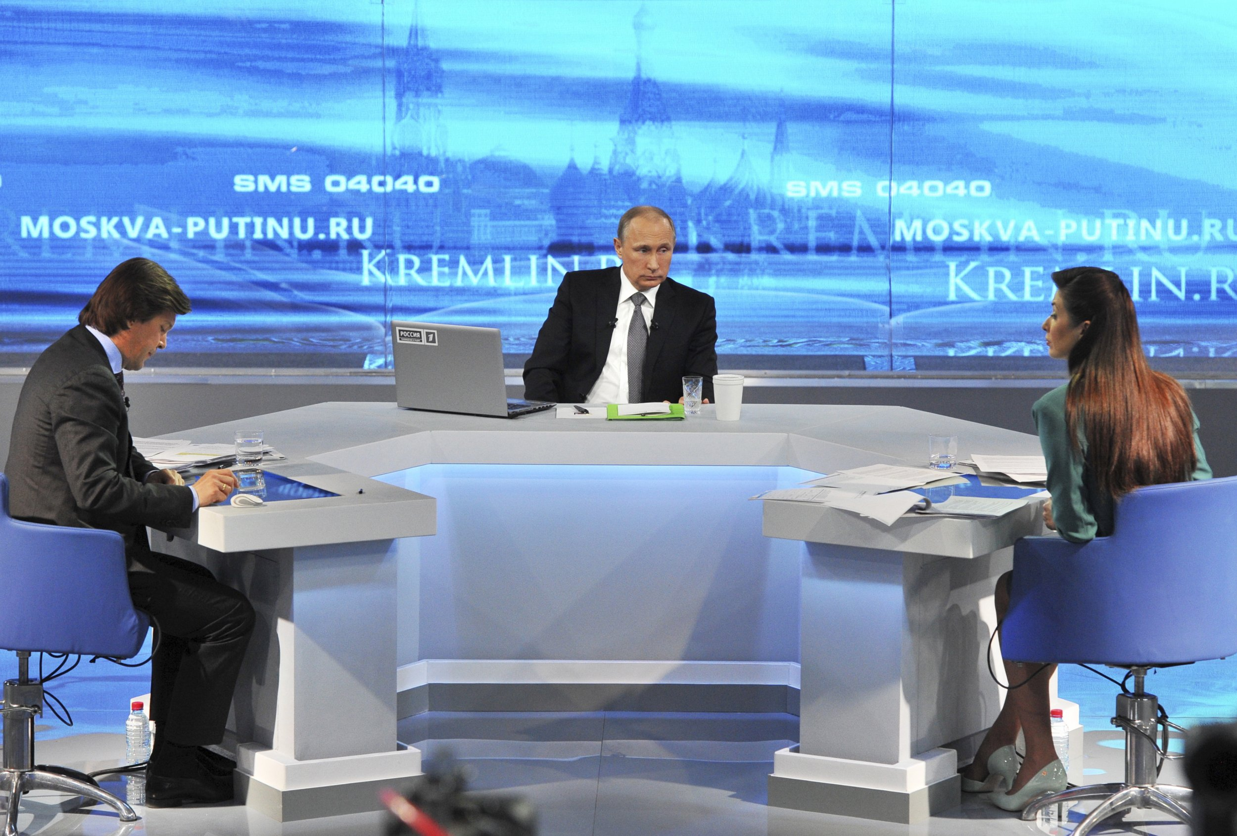Putin sits at his desk during the telethon